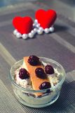 Two desserts with a heart and beads Stock Photo