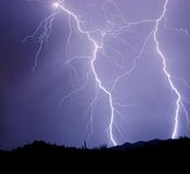 Two Detailed Lightning Strikes. With numerous branches striking in the desert Stock Image