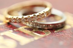 Diamond wedding bands. Two diamond wedding bands for a double bride wedding on the cover of the bible Royalty Free Stock Image