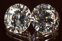 Two diamonds. Two elegant diamonds with reflection on the floor Stock Photography