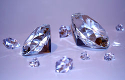 Two diamonds with fragments Stock Photography