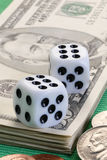 Two dice. And some dollar bills Royalty Free Stock Photography