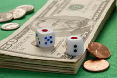Two dice. And some dollar bills Stock Photography