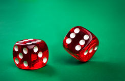 Two dice. On a green background Stock Photo