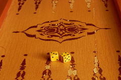 Two dice are on Board for backgammon game. Two dice are on the Board for the backgammon game Royalty Free Stock Photo