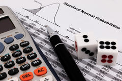 Two dice, calculator and pen  Stock Image
