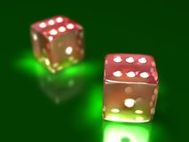 Two dice on a game table in a casino Stock Photos