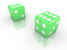Two dice in green both with six up Stock Image