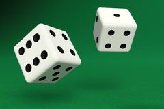 Two dice on green felt Royalty Free Stock Image