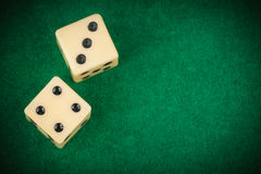 Two dice on a green gaming table Royalty Free Stock Photos