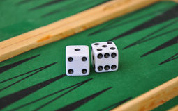 Two dice on a green gaming table. Royalty Free Stock Images