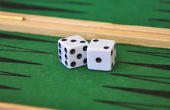 Two dice on a green gaming table. Royalty Free Stock Photography