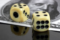 Two dice and hundred dollars background Royalty Free Stock Image