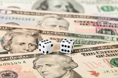 Two dice on money Stock Image