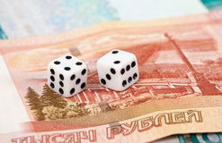 Two dice and money Stock Photos