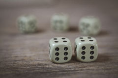 Two dice number double six on a wooden table Royalty Free Stock Photos