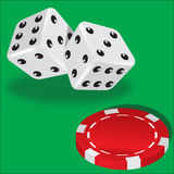 Two dice and red poker chips Stock Images