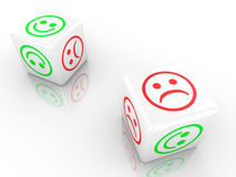 Two dice showing smiling and sad faces Stock Photography