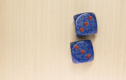 Two dice on a wood surface Royalty Free Stock Images