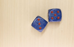 Two dice on a wood surface Royalty Free Stock Photos