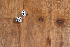 Two dice on wooden background Stock Photo