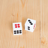 Two dice on wooden table Royalty Free Stock Photo