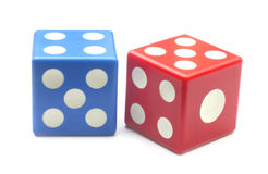 Two dices. Of red and blue colors over white background Royalty Free Stock Photo