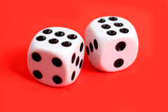 Two dices. On a red background. Two sixes stock image