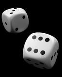 Two dices on black Royalty Free Stock Images