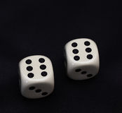 Two dices double six on a black Stock Images