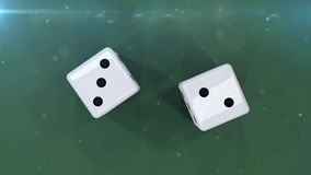 Two dices on a green background showing a five Stock Photography