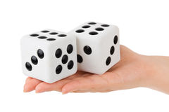 Two dices in hand Stock Image