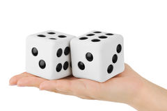 Two dices in hand Royalty Free Stock Image
