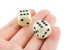 Two dices on hand Stock Images