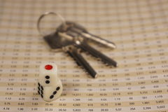 Two dices with keys Royalty Free Stock Photos