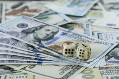Two Dices and Many Cash Stock Photography