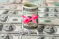 Two dices on money background Stock Photography