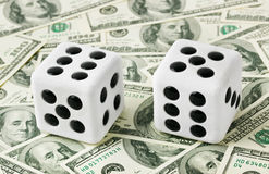 Two dices on money background Stock Photo
