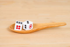 Two dices in wood spoon Royalty Free Stock Images