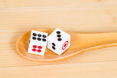 Two dices in wood spoon Royalty Free Stock Image