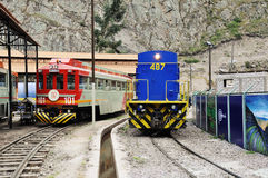 Two diesel locomotives. Two diesel locomotives of 'Inca Rail' and 'Perurail' railway companies are ready to depart to Machu Picchu on May 14, 2013 in royalty free stock photography