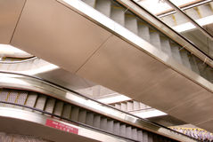 Two difference ways escalators in modern building Royalty Free Stock Images