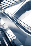 Two difference ways escalators in modern building Royalty Free Stock Photos