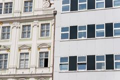 Two different buildings. Modern and old-fashioned royalty free stock photography