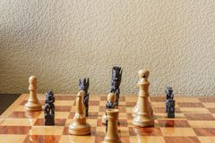 Two different cultures came together on a chessboard. Concept Royalty Free Stock Photos