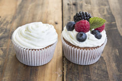 Two Different Cupcakes  on a Rustic Wooden Table Stock Photography