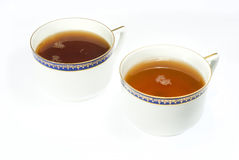 Two different cups of tea Royalty Free Stock Images