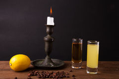 Two different drink on a wooden table with a candlestick Royalty Free Stock Photography