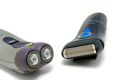 Two different electric shavers Stock Photos