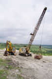 Two different excavator in sand quarry Royalty Free Stock Photos